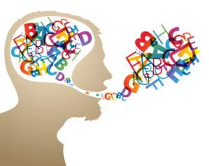 Abstract speaker silhouette with colorful letters in the head and mouth